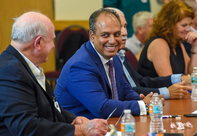 Cleveland Clinic Florida President Dr. Wael Barsoum speaks with Indian River Medical Center Board of Directors Chairman Wayne Hockmeyer on Sept. 25, 2018 when the terms of the merger were announced.