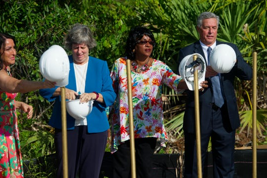 St. Lucie County Public Schools board members Carol Hilson (from left), Debbie Hawley, Dr. Donna Mills and Superintendent Wayne Gent don hardhats Tuesday, Sept. 25, 2018 for a ground-breaking ceremony for a new district headquarters in Port St. Lucie.
