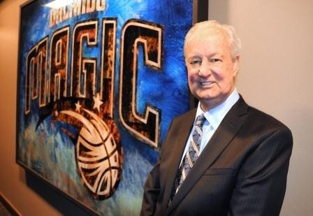 Pat Williams stands by an Orlando Magic mural at the Amway Center.