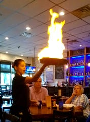 Saganaki is flaming Greek Kasseri cheese, cooked golden brown and flamed with brandy, at Olympic Taverna in Palm City.