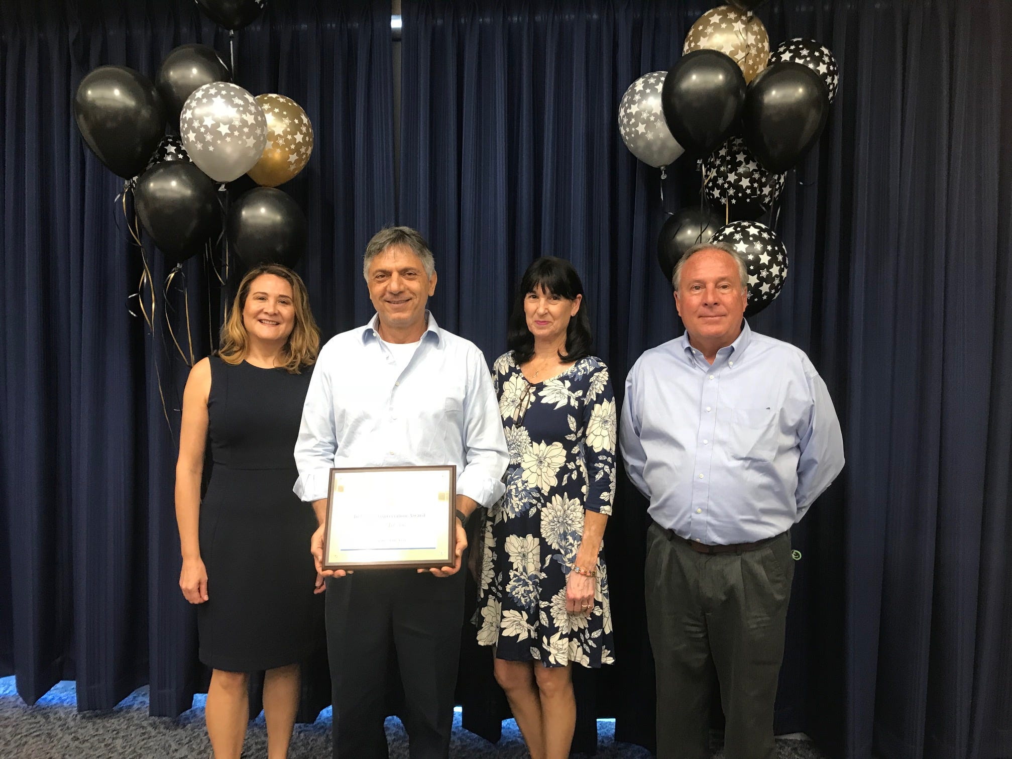 Paris Air was named Mid-size Company  of the Year -- Cecelia Christodoulids, Paris Christodoulids, Lynn Lilliquist and Jay Elde
