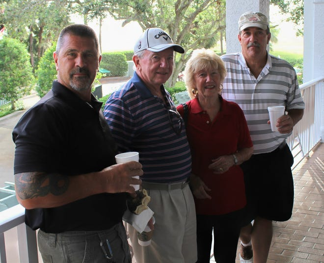 """Dennis Hobt, left, Ed Sheridan, Diana D'Angelo and Rich Vartigan starting the morning with breakfast at the 2017 """"Hackers for Vets"""" golf tournament."""