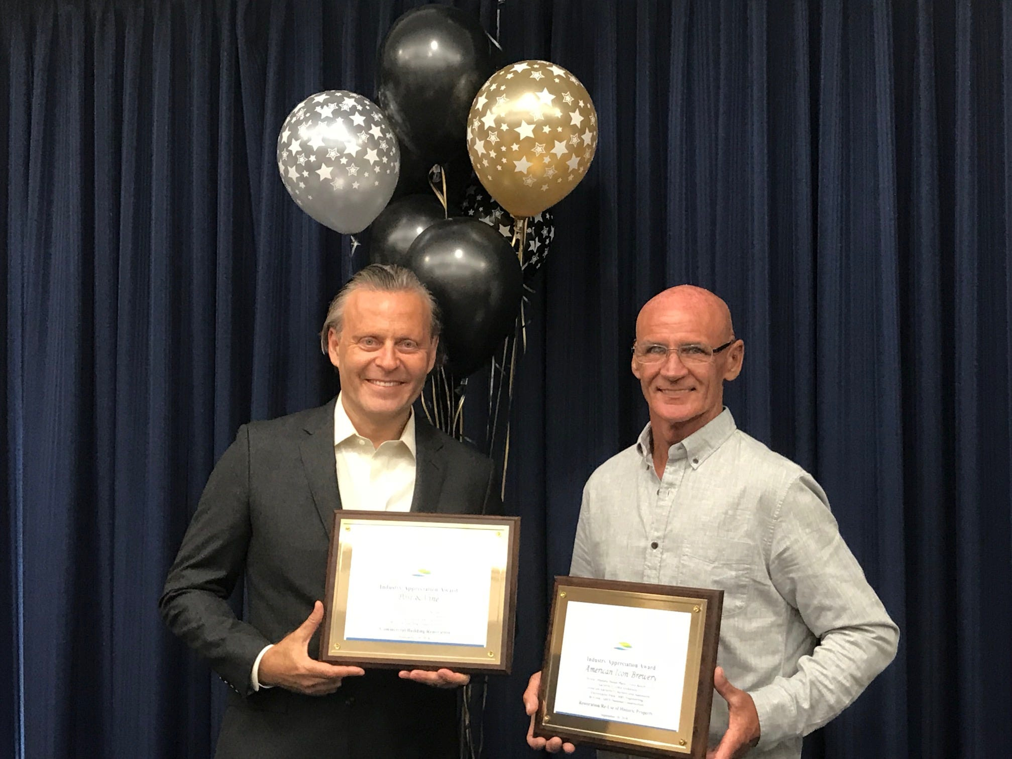 Michael Rechter And Ashley Green with awards for Post & Vine And American Icon Brewery (mid-size renovation and Restoration and Re-Use of Historic Property.)