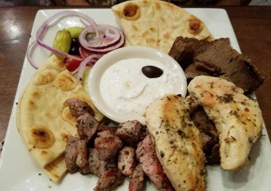 A gyro, souvlaki and chicken trio platter is an option at Olympic Taverna in Palm City.