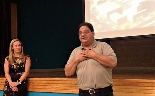 Fred Borrego, president of the San Juan Neighborhood Association, talks about the Medical Center of the Americas master plant as Emma Schwartz, president of the MCA Foundation, listens.