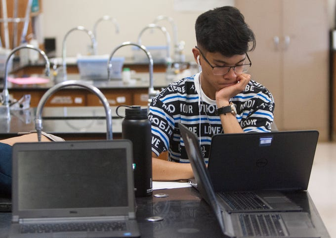Jayson Gutierrez works on a project in the International Baccalaureate chemistry class at Rio Mesa HIgh School.