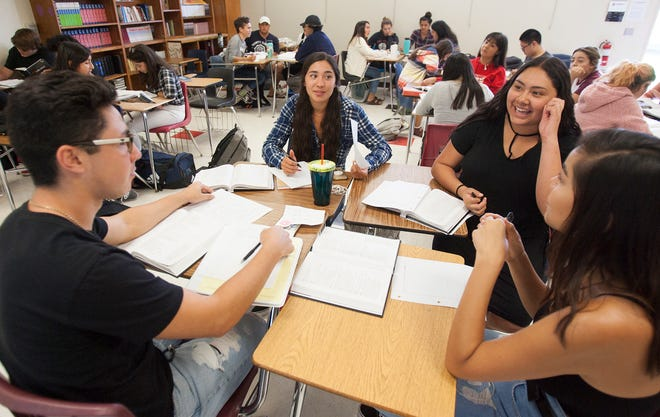 "Dylan Quintana, from left, Sophia Almazan, Galilee Ramirez and Corina Gonzalez discuss the William Shakespeare play ""Hamlet"" during their International Baccalaureate English class at Rio Mesa High School."