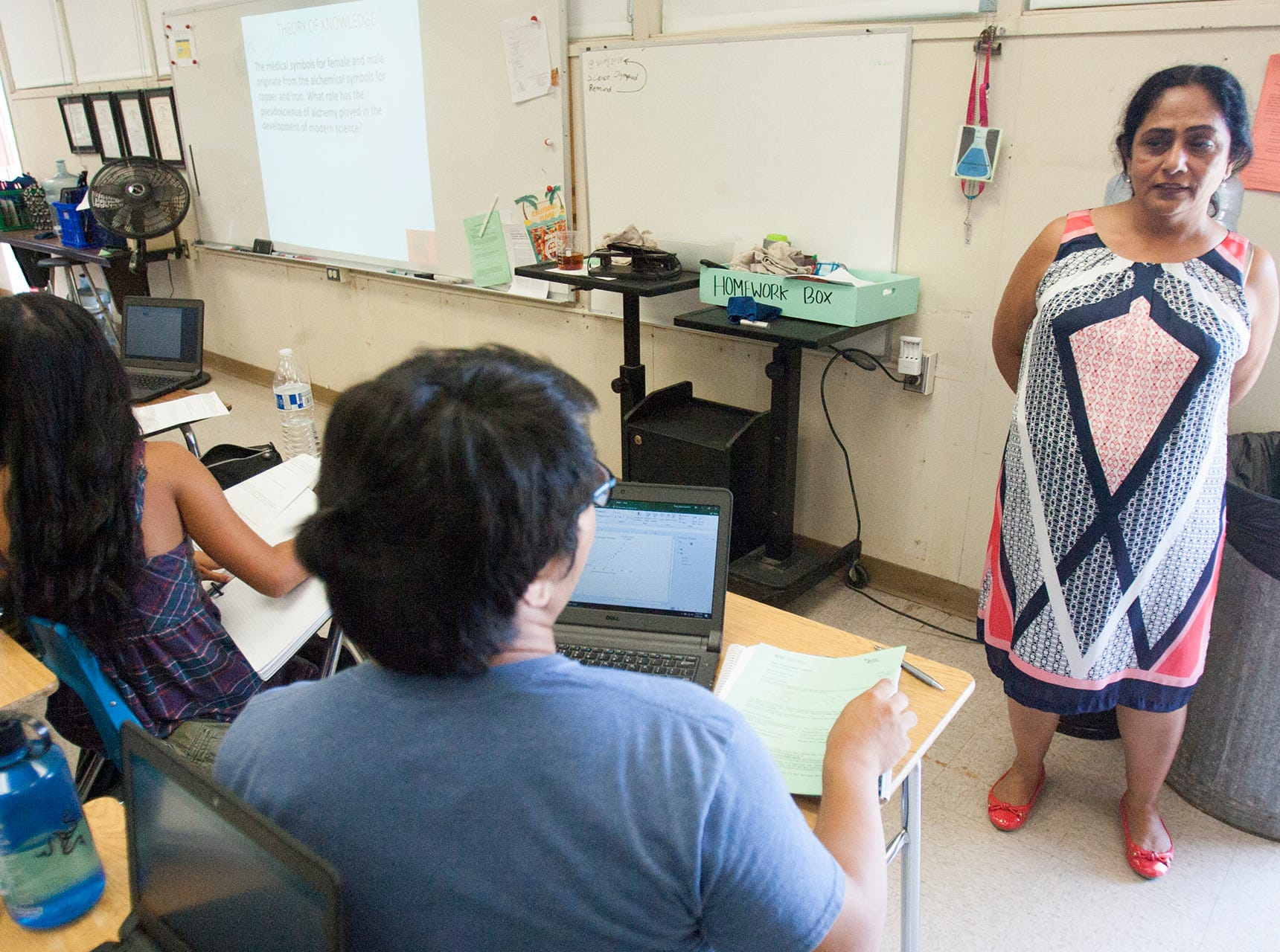 Rano Sidhu, right, talks to her students while teaching the International Baccalaureate chemistry class at Rio Mesa High School.