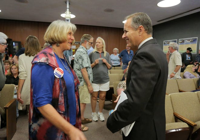 Aaron Starr, right, chats with a supporter at the Oxnard City Council Chambers after an elections event last year.