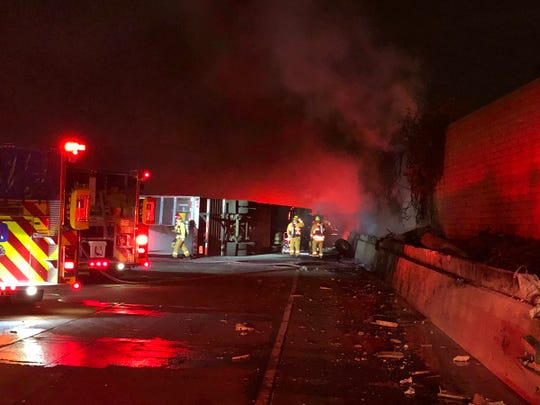 Crews work on a fire caused by a semitrailer crash Tuesday morning on Highway 101 in Camarillo that closed all lanes.