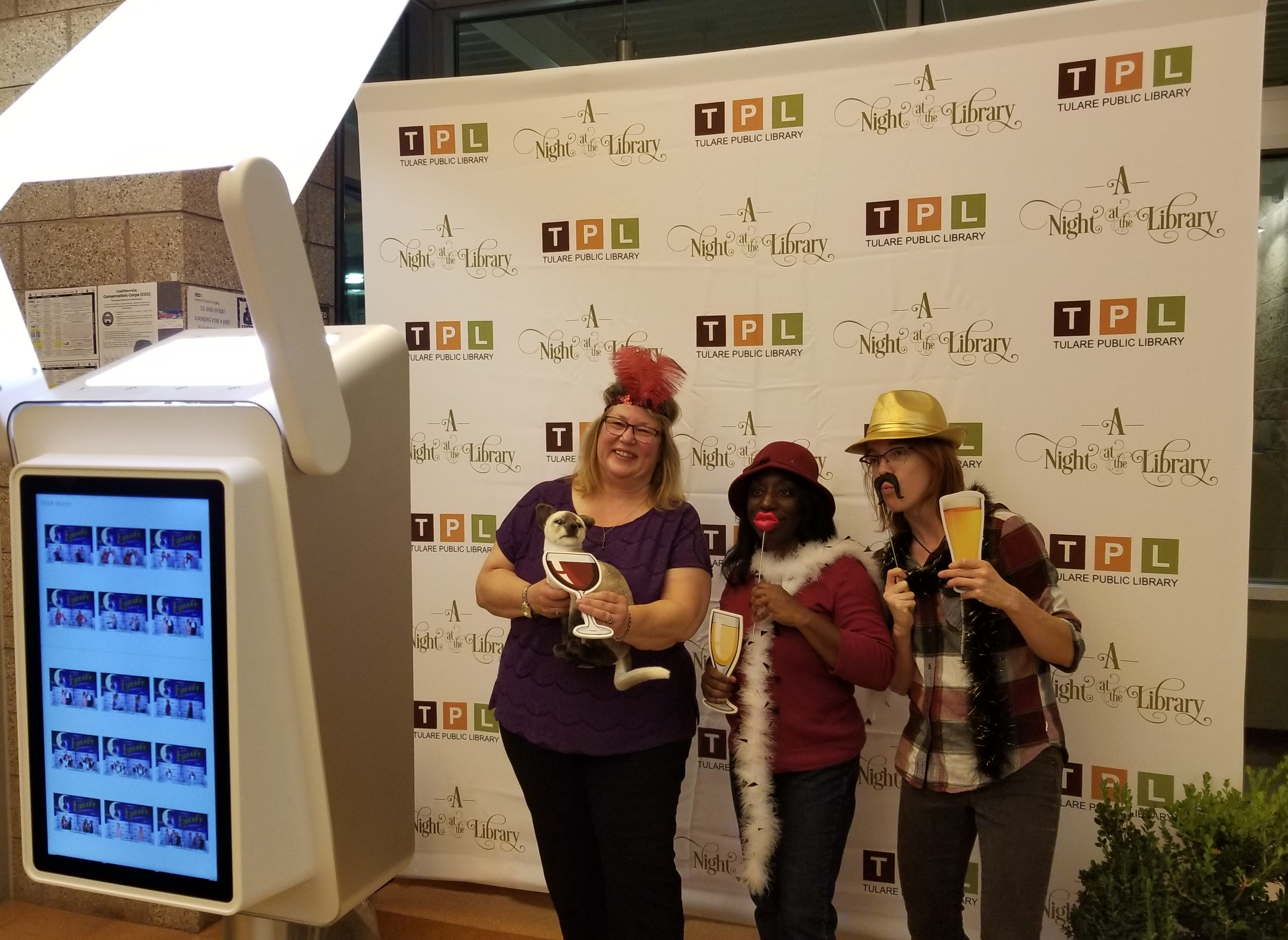 Attendees mug it up for the newest addition to 'Night at the Library' - a photo booth.