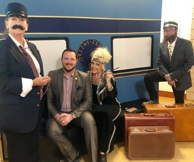 Assemblyman Devon Mathis takes a ride on the 'Orient Express' at Tulare Public Library's 'Night at the Library' fundraiser