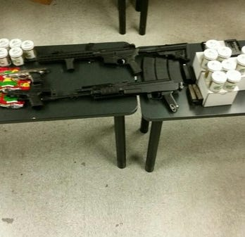 Tulare County detectives find 1 lb. of honey oil, guns during drug bust