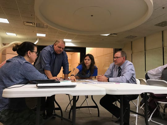 Wausau community members, along with mayor Robert Mielke, center, come up with ideas for how to handle traffic on Forest and Washington Streets in downtown at a public input meeting on Monday, Sept. 24.