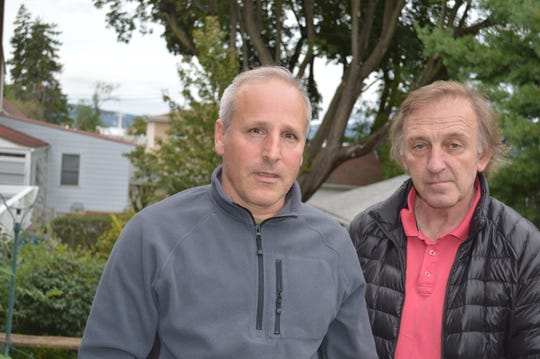 Tarrytown residents Peter Bartolacci, left, and Dan Hanover, want the MTA to dismantle its cell tower by the Hudson River.