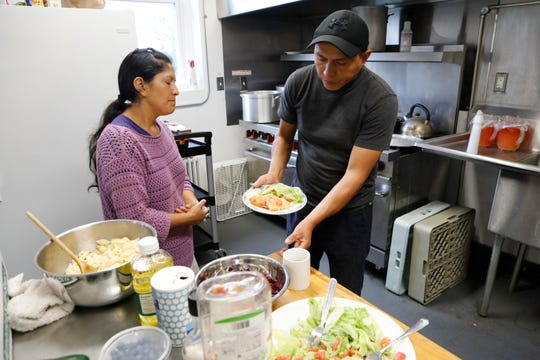 Gloria Guambana, 21, with her father Juan and mother Maria in the kitchen at the South Presbyterian Church in Dobbs Ferry on Sept. 25, 2018.