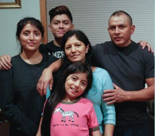 Juan Guambana and his wife Maria Tenesaca of Ossining, photographed with their three children, have sought refuge in a Dobbs Ferry church to stave off deportation by immigration authorities.