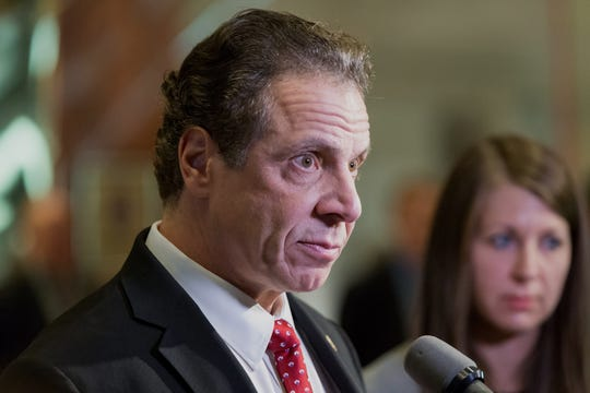 Andrew Cuomo, governor of New York, speaks with members of the media in the lobby of Trump Tower in New York, U.S., on Wednesday, Jan. 18, 2017. President-elect Donald Trump has made job creation one of his signature issues, setting off a flurry of corporate pledges to hire more workers. Photographer: Albin Lohr-Jones/Pool via Bloomberg