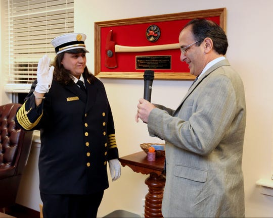 Photos by Peter Carr/The Journal News Kelly Murphy is sworn in as Tarrytown Fire Department?s first female chief by Tarrytown Mayor Drew Fixell, Friday. Kelly Murphy is sworn in as Tarrytown Fire Department's first female chief by Tarrytown Mayor Drew Fixell April 8, 2016.