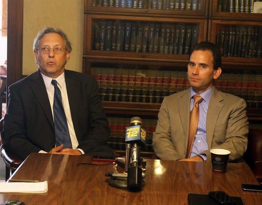 From left, attorney Michael Sussman and Putnam County District Attorney Adam Levy announce Levy's defamation lawsuit against Putnam Sheriff Donald Smith, while in his lawyers office in Carmel Aug. 14, 2013. ( Frank Becerra Jr / The Journal News )