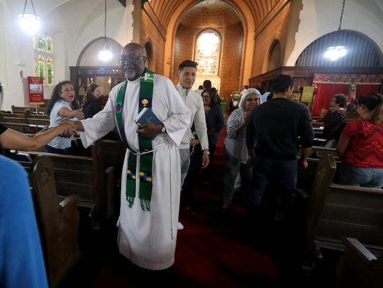 Hilario Albert, recently retired pastor at St. Peter's Episcopal Church in Port Chester, greets congregants during a Spanish language Sunday Mass Sept. 9, 2018. The church holds two separate Sunday masses, one in English and another in Spanish. The Spanish language service attracts a greater number of attendees than the English language service.