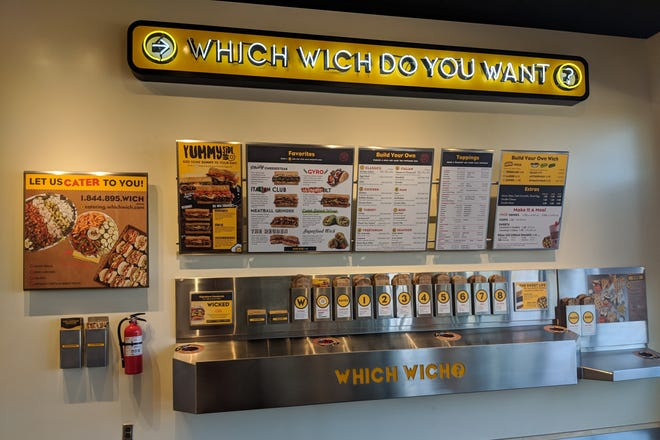 The wall where you pick a bag and fill it out with your order. You then take it to the counter to pay and the workers call you once your meal is ready to be picked up.