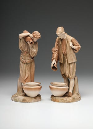 This pair of Royal Worcester water carriers sold for $240. They are large enough to be important decorations on a table, but most of your guests won't realize how important they were to life in a Victorian city.
