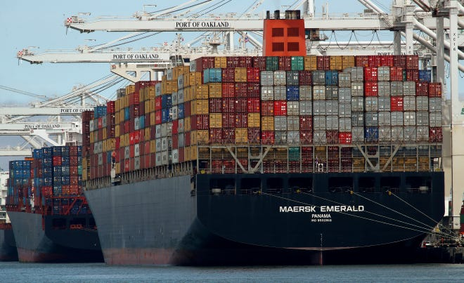 FILE - In this Thursday, July 12, 2018, file photo, the container ship Maersk Emerald is unloaded at the Port of Oakland, Calif. China has raised tariffs on $60 billion of U.S. imports in an escalation of their trade battle following a deadline for President Donald Trump's latest increase.