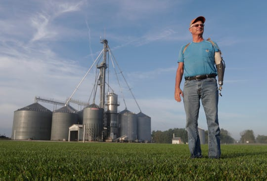 """Jack Maloney poses in front of the grain bins on his Little Ireland Farms in Brownsburg, Ind., Wednesday, Sept. 12, 2018. Maloney, who farms about 2,000 acres in Hendricks Count, said the aid for farmers is """"a nice gesture"""" but what farmers really want is free trade, not government handouts. American farmers will soon begin getting checks from the government as part of a billion-dollar bailout to help those experiencing financial strain from President Donald Trump's trade disputes with China."""