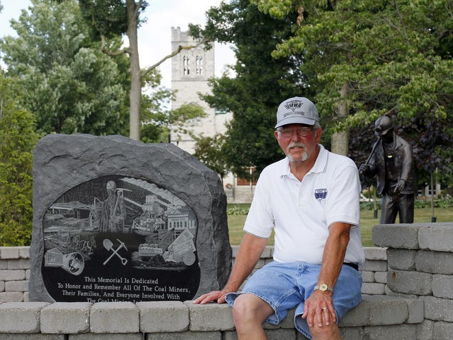 David H. Dilly, of Fresno, sits near a monument and memorial for mine workers in Coshocton County. Dilly, a member of United Mine Workers Local 1188, was a mine worker for almost 20 years. His father also was a mine worker and died of black lung. Retired coal miners and their widows are on Capital Hill this week asking Congress to pass what United Mine Workers of America describes as life-or-death legislation to preserve their benefits.