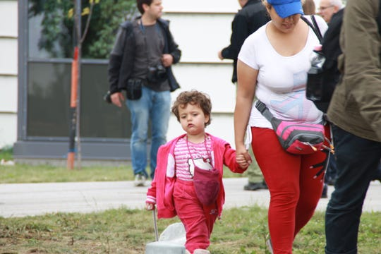 A mother and her toddler walk across the Hungarian border to Nickelsdorf, Austria, on Sept. 5, 2015.