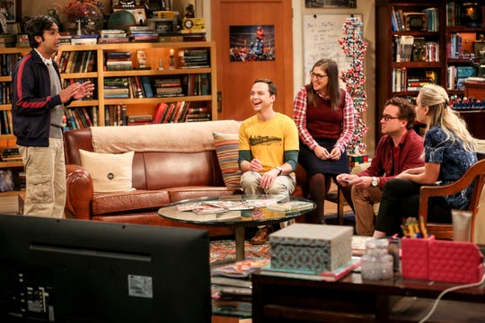 "Rajesh (Kunal Nayyar), left, tells Sheldon (Jim Parsons), Amy (Mayim Bialik), Leonard (Johnny Galecki) and Penny (Kaley Cuoco) his romance strategy on Thursday's episode of ""The Big Bang Theory."""