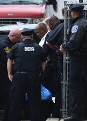 Cosby is ushered to an SUV following his sentencing. He will spend the first few days of his prison term being processed at the county jail and then taken to state prison for assessment.