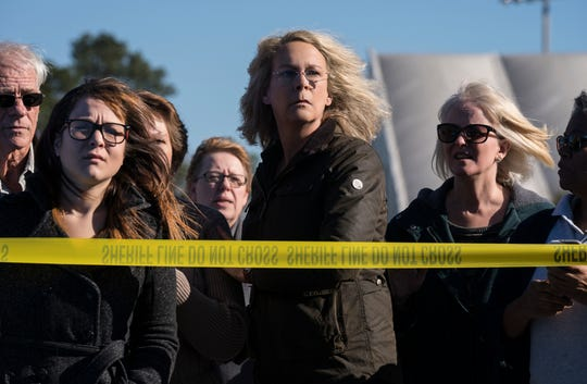 """Laurie Strode (Jamie Lee Curtis, center) worries that Michael Myers is on the rampage again in """"Halloween."""""""