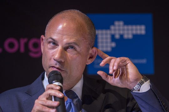 Attorney Michael Avenatti makes a listening gesture during a city-sponsored panel discussion on July 26, 2018 in West Hollywood, California. During the discussion, Avenatti announced that he is representing three more women who will come forth to claim they were paid by Donald Trump, AMI Entertainment and Michael Cohen to remain silent. Avenatti represents Stormy Daniels in her lawsuit against President Trump over a $130,000 payment to silence her about an alleged affair with Trump.