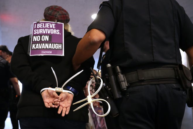 U.S. Capitol Police arrest protesters who were demonstrating against the confirmation of Supreme Court nominee Brett Kavanaugh in the Hart Senate Office Building Sept. 25 in Washington.