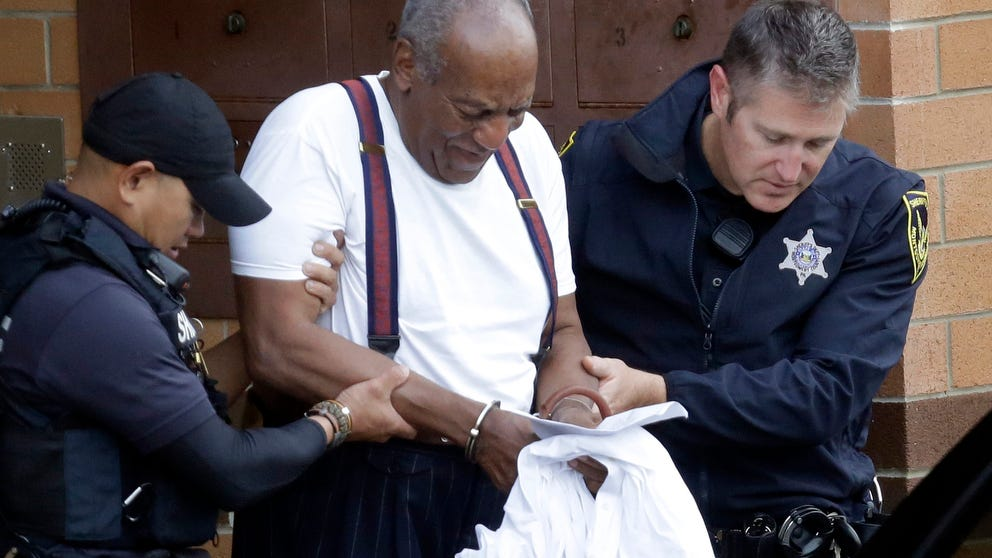 Bill Cosby is escorted out of the Montgomery County Correctional Facility,  Sept. 25, 2018, in Eagleville, Pa., following his sentencing to three-to-10-year prison sentence for sexual assault.