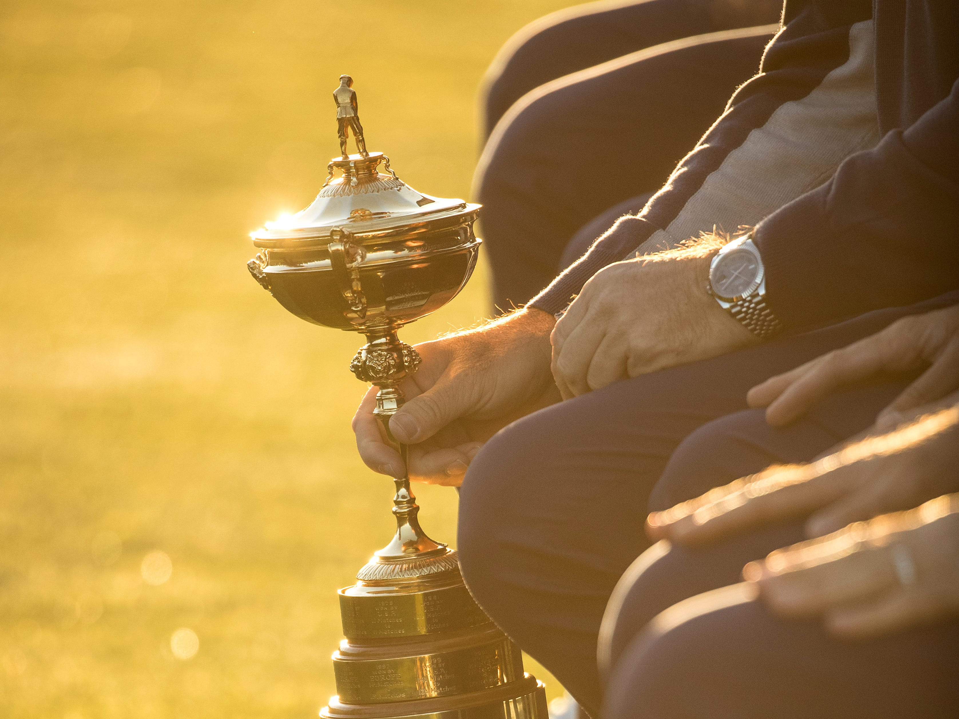 Captain Thomas Bjorn of Europe lifts up the Ryder Cup trophy during a European Team photo shoot.