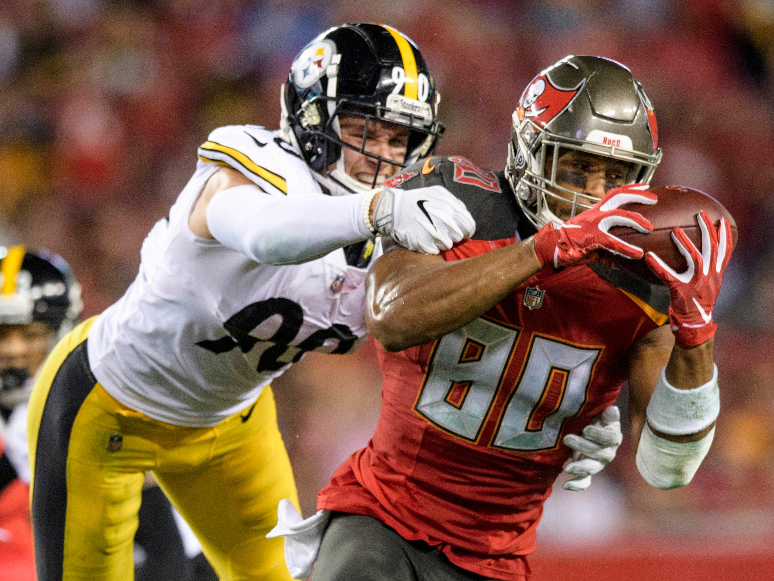 Tampa Bay Buccaneers tight end O.J. Howard catches the ball in front of Pittsburgh Steelers linebacker T.J. Watt during the first half at Raymond James Stadium.