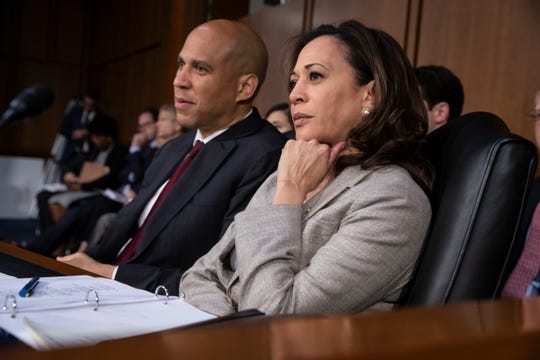 Sen. Cory Booker, D-N.J., left, and Sen. Kamala Harris, D-Calif., sit together on the last day of the Senate Judiciary Committee's confirmation hearing for President Donald Trump's Supreme Court nominee, Brett Kavanaugh, on Capitol Hill in Washington on Sept. 7, 2018.