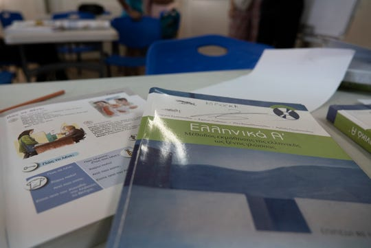 09/04/2018 ELEONAS REFUGEE CAMP, ATHENS, GREECE. The books used by refugee children to learn Greek at one of the six educational centers, run by Elix, a Greek NGO that caters to 2,500 refugee children and adults. Elix offers supportive classes to refugee children that go to Greek public school, as well as their parents.