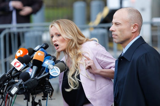 (FILES) In this file photo taken on April 16, 2018 adult-film actress Stephanie Clifford, also known as Stormy Daniels, speaks US Federal Court with her lawyer Michael Avenatti (R) in Lower Manhattan, New York.