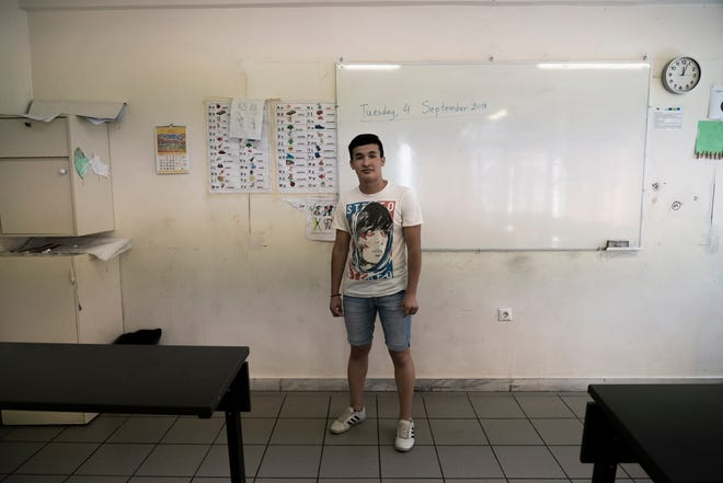 09/04/2018 ATHENS, GREECE. Abdull Rashid, 16, from Afghanistan wants to study in university and become a journalist. Rashid is standing in one of the classrooms of the six educational centers, run by Elix, a Greek NGO that caters to 2,500 refugee children and adults. Elix offers supportive classes to refugee children that go to Greek public school, as well as their parents.