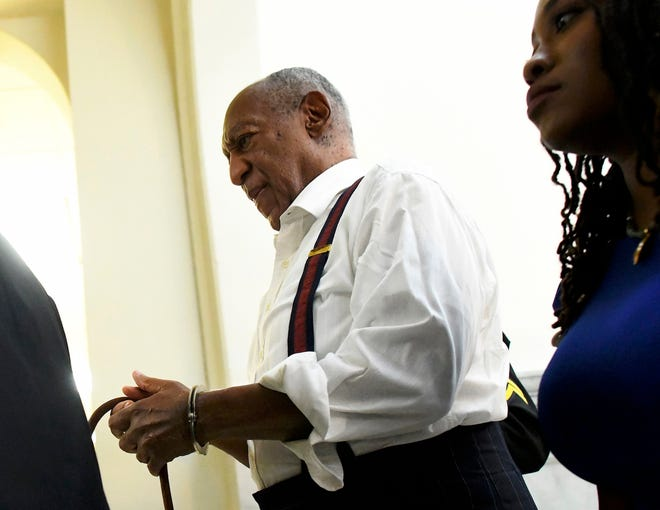 A handcuffed Bill Cosby is taken away in handcuffs after he was sentenced to three-to 10-years for felony sexual assault on Tuesday, Sept. 25, 2018, in Norristown, Pa.