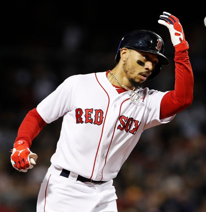 Mookie Betts rounds the bases after hitting a two-run homer against the Orioles.
