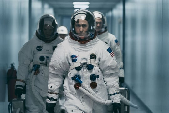 L to R, Foreground): Lukas Haas, Ryan Gosling and Corey Stoll in FIRST MAN. On the heels of their six-time Academy Award®-winning smash, La La Land, Oscar®-winning director Damien Chazelle and star RYAN GOSLING reteam for Universal Pictures' First Man, the riveting story of NASA's mission to land a man on the moon, focusing on Neil Armstrong and the years 1961-1969.