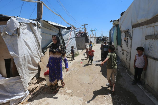 Syrians in a refugee camp near Zahle, Lebanon, on June 23, 2018.