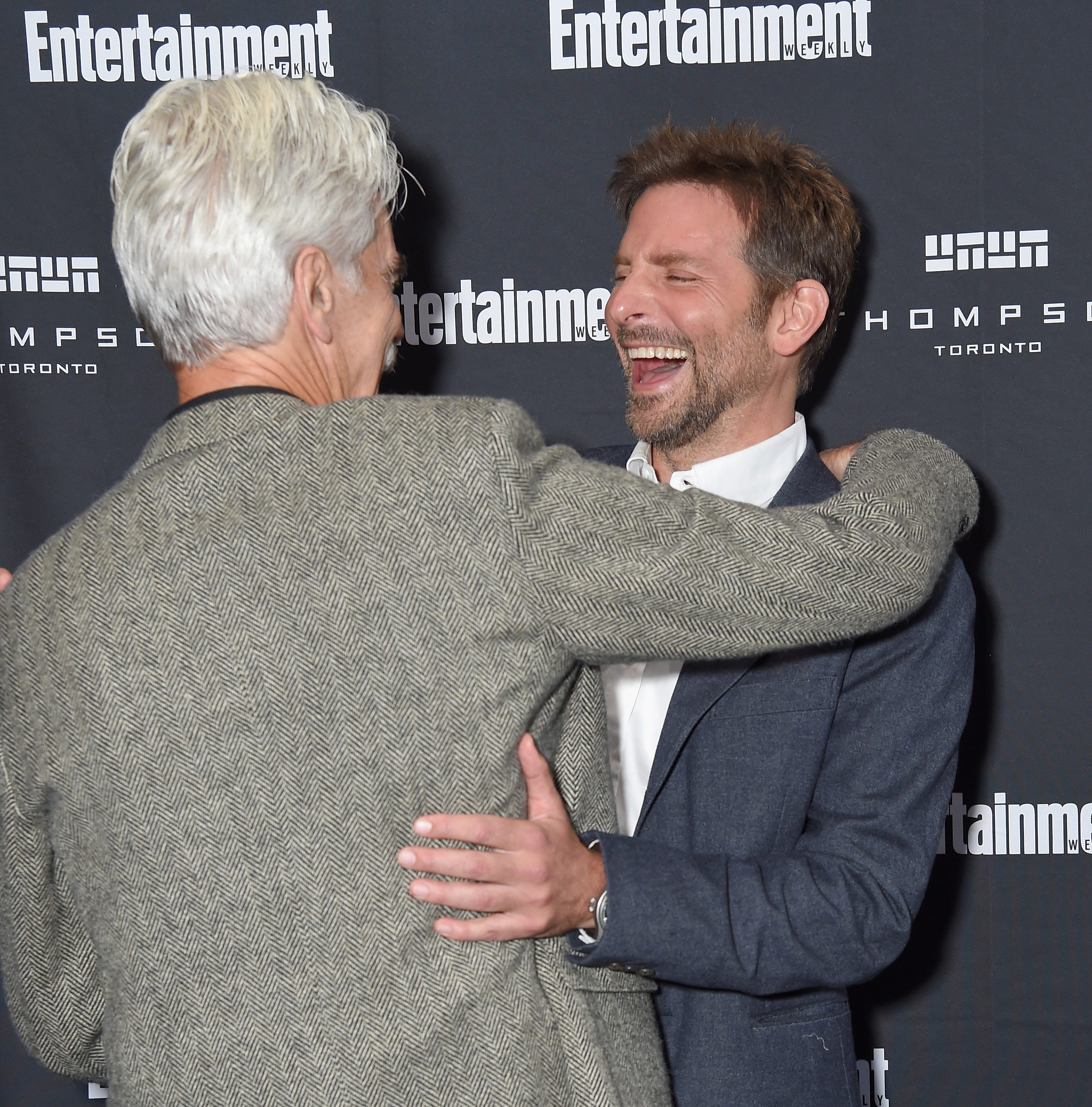"Sam Elliott, left, hugs ""A Star Is Born"" director and co-star Bradley Cooper. Elliott's voice inspired Cooper's in their movie."