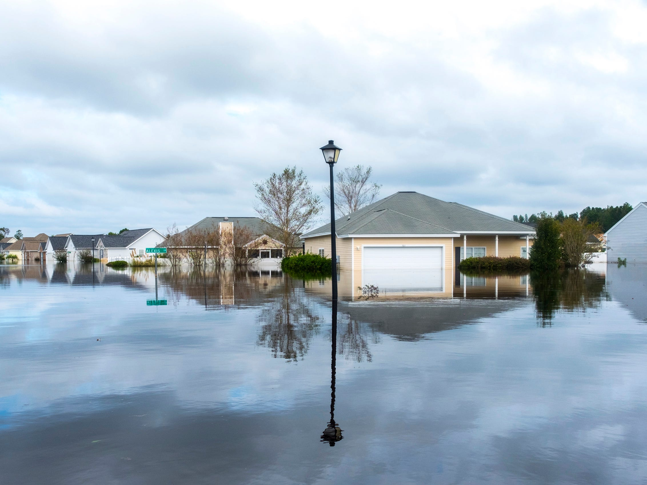 The Polo Farms neighborhood off S.C. Highway 905 is largely underwater, on Monday, Sept. 24, 2018, in Longs, S.C., due to Hurricane Florence's deluge.