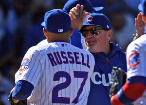 Russell and Maddon after a win against the Brewers in April.
